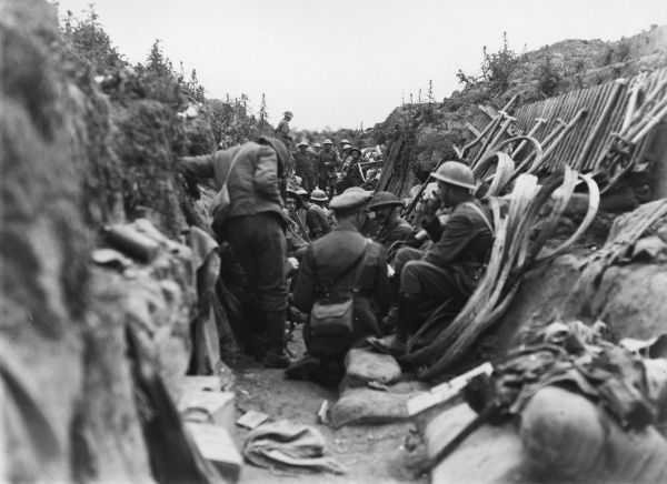 The scene in a British communications trench. Troops gather, shortly before they are given the order to advance during the Battle of Albert in the first few days of the Somme campaign
