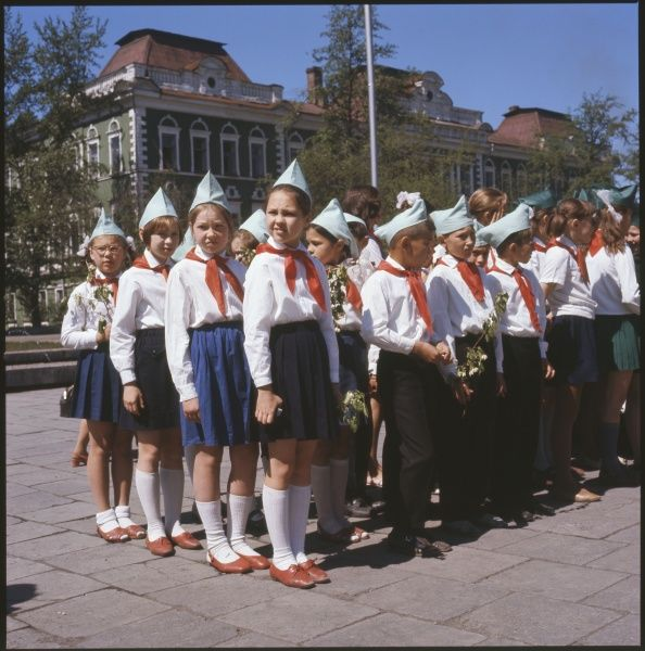 A smartly-dressed group of boys and girls, the Red Pioneers, a communist youth organisation, Irktusk, USSR