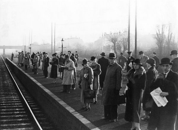 A crowded platform of rush hour commuters waiting for a train on Malden station. Date: 1930s