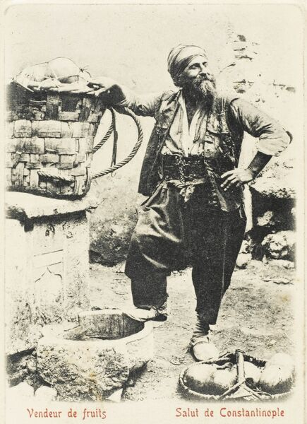 Constantinople - A happy fruit vendor, standing next to a well