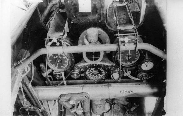 A close-up view of the controls and instrument panel in the cockpit of a British plane in service during the First World War.  1914-1918