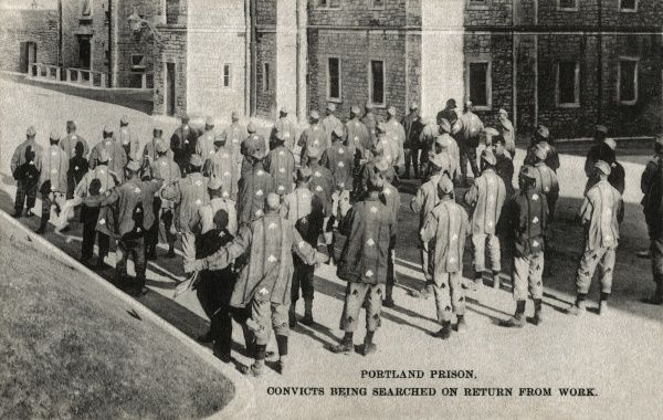 Portland Prison, Dorset, opened in 1848 as a public works prison for convicts who were employed in quarries in the area. This view shows prison officers searching convicts on their return from work