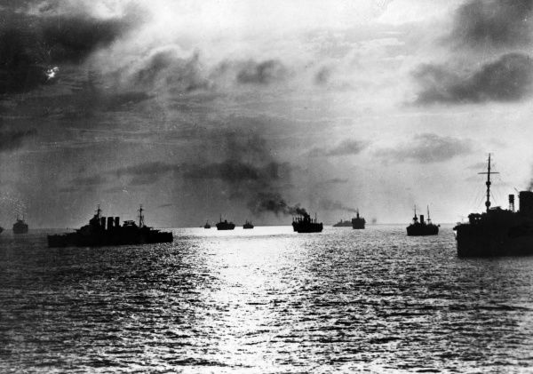 A convoy of ships at dusk Date