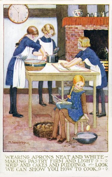 A group of girl guides busy in a kitchen making pastry and cakes