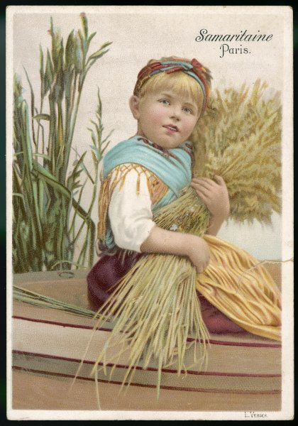 Small girl with a wheatsheaf = a rather corny picture