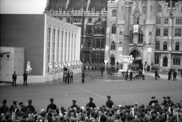 The temporary construction comprising the Queen's entrance and reception hall. Outside, the array of Queen's beasts can be seen along the wall of the reception hall. 1953