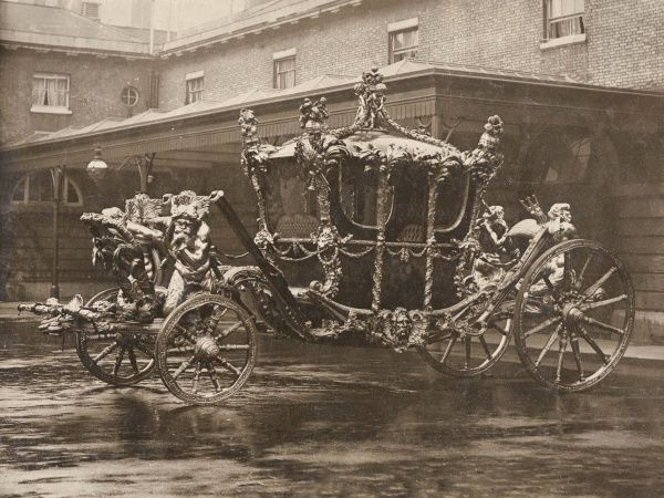 The Coronation Coach, soon to be used for the Coronation of King George V, in the Royal Mews in Central London
