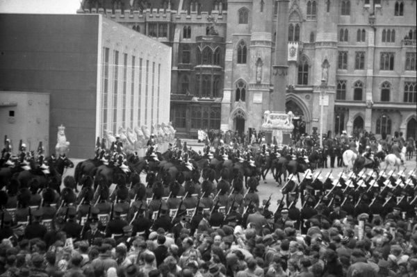 Household Cavalry, escort to The Queen, moves down Victoria Street. 1953