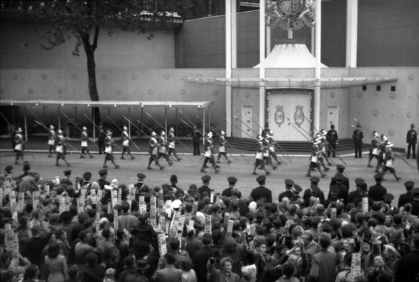 The main body of the Pikemen and Liverymen of the City of London march past the west door of the Abbey on their way to take up position on the route. 1953