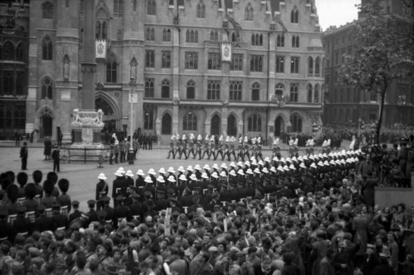 March towards the Abbey. In the foreground the Guard of Honour mounted by The Royal Marines. The marching column is a group of members The Life Guards of the Household Cavalry on foot. 1953