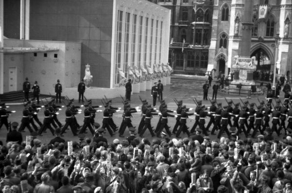 R.A.F. Regiment march past the Abbey West Door at on their way to take up position as part of Guard of Honour. 1953