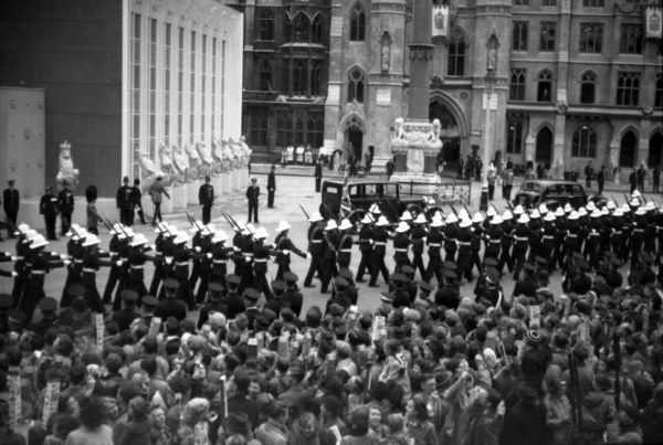 A contingent of The Royal Marines march into position as part of the Guard of Honour outside the west door of the Abbey. They will hold a position to the extreme right of the picture. 1953