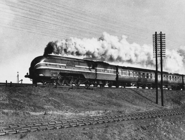 The 'Coronation Scot' steam locomotive seen, at speed, on its non-stop run between Glasgow, Scotland and London Euston, England