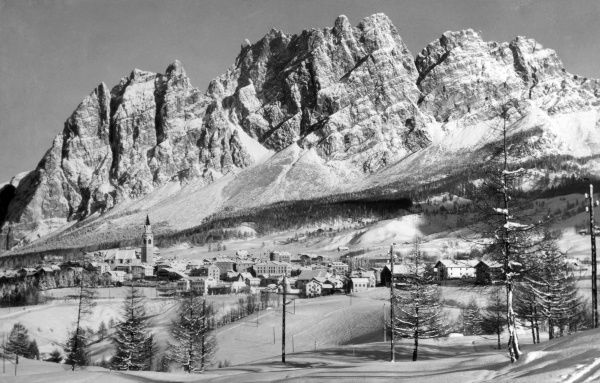 A charming photograph of the town of Cortina d'Ampezzo, Monte Cortina and Monte Pomagagnon, the Dolomites, northern Italy. Date: 1930s