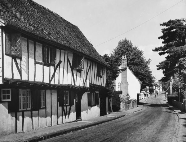 Picturesque black and white timber and plaster cottages in the street at Much Hadham, a charming Hertfordshire village