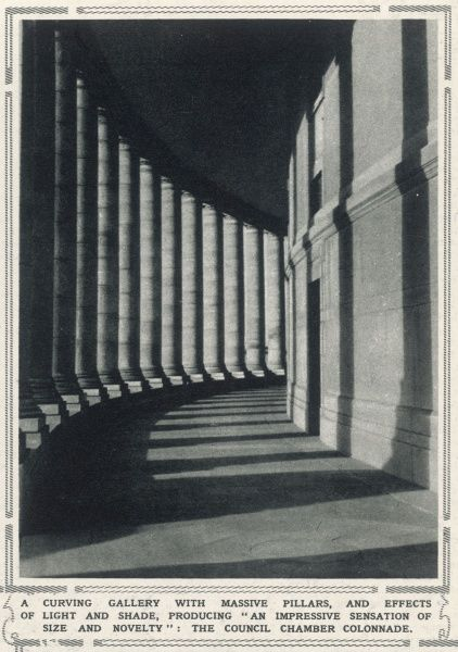 "A curving gallery with massive pillars, and effects of light and shade, producing an ""impressive sensation of size and novelty"": the council chamber colonnade in New Delhi, pictured on the eve of its inauguration as captial of India"