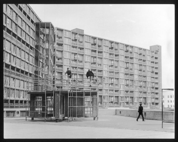 Boys play on a climbing frame outside blocks of council flats on the Parkhill Estate, Sheffield