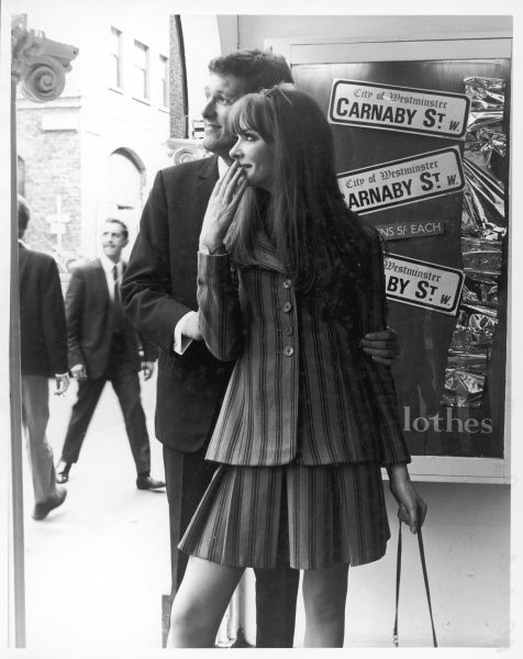 A suitably dressed couple shopping on Carnaby Street, the hip centre of swinging London