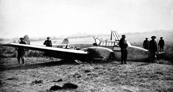 Photograph showing a German Messerschmitt Me-110 fighter-bomber, which crash-landed near Hastings after being shot up by a British fighter, during the summer of 1940. A number of British soldiers can be seen guarding the airplane