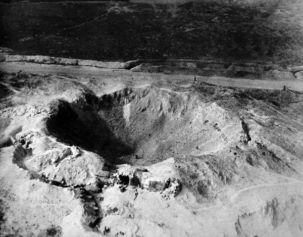 Aerial view of a crater formed by a mine explosion on the Western Front, 1915