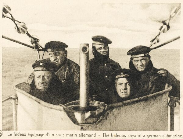The 'hideous crew' (!) of a German U-boat Submarine, poking their head out from the viewing platform, with the periscope in front. A very direct Allied propaganda postcard