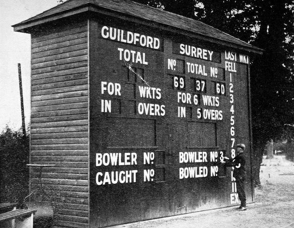 Photograph showing the scoreboard at Guildford Cricket Ground, venue of the Surrey vs