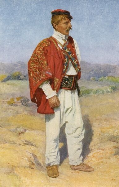 Croatia - Traditional National Costume (4/8) - young man standing in the sand dunes
