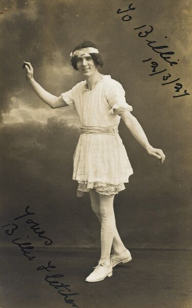 An amusing postcard depiction of a cross-dressing male stage performer from the north-west of England in frilly white dancer's attire and silk headband