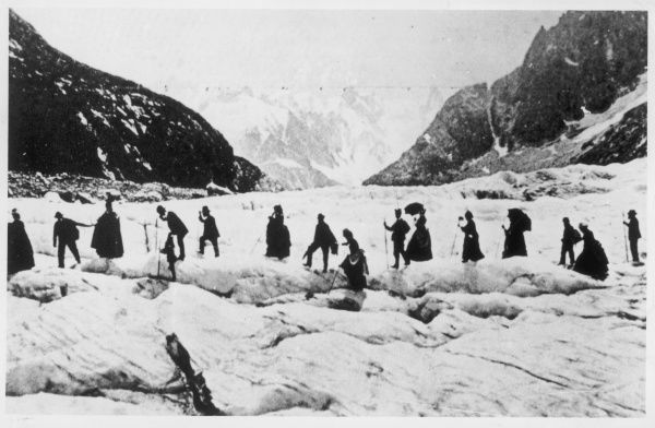 A smartly attired group of walkers cross the Mer de Glace at Chamonix, France.  circa 1880