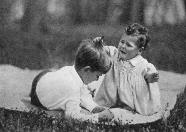 A candid photograph of Crown Prince Peter of Yugoslavia (later King Peter II) with his younger baby brother, Prince Tomislav in the park of the castle at Dedinje near Belgrade in 1930. Date: 1930