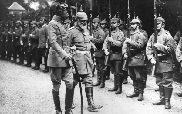 Crown Prince Friedrich Wilhelm Victor August Ernst of Prussia (1882-1951). Seen here in uniform (left), inspecting troops during the First World War. He was made commander of the 5th Army in August 1914, and continued in the role until November 1916