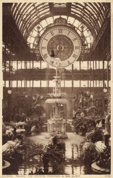View of the Crystal Fountain and Big Clock (made by Dent of the Strand) in the Crystal Palace, South London. Date: circa 1930s