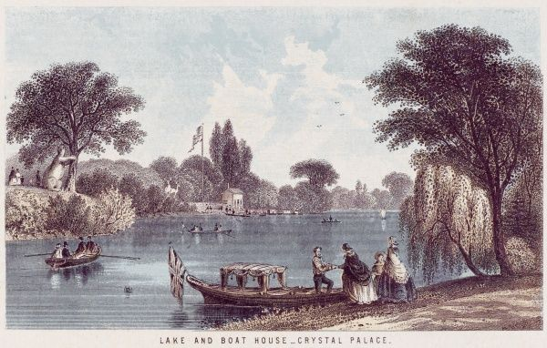 The picturesque boating lake is a popular feature of the Palace grounds : around 1900, an electric canoe will ply its waters