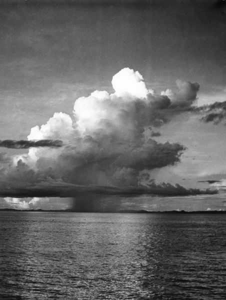 Dramatic Cumulus Nimbus clouds at sea, the sign of an approaching rain storm. Date: 1960s