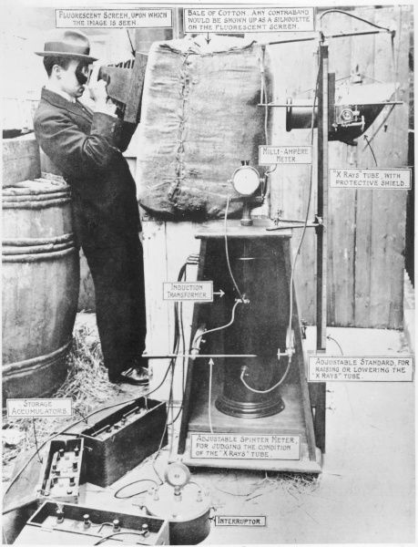 An officer examines a bale of cotton with an X-ray machine to try and detect contraband during World War I in March 1915