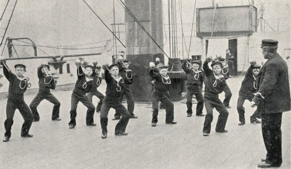 Boys taking part in a cutlass exercise on the Training Ship Wellesley, on the River Tyne at North Shields, Northumberland