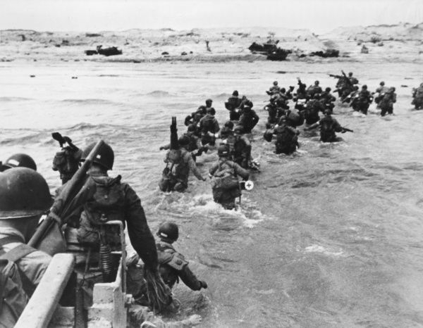 US Assault troops wading ashore. D-Day began on June 6th, 1944 at 6:30am and was conducted in two assault phases - the air assault landing of allied troops followed by an amphibious assault by infantry