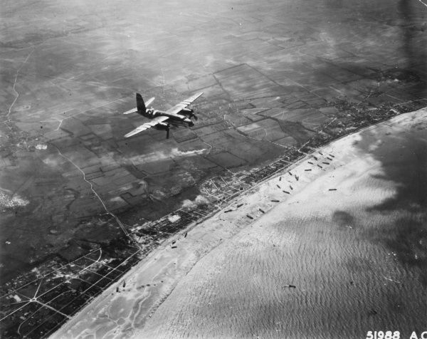 A B-26 Martin Marauder of the 9th Airforce over the Normandy coast, giving air support to the landing craft on the beaches below