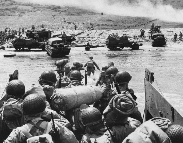 American assault troops prepare to disembark their landing craft as it approaches the beach head, Omaha Beach