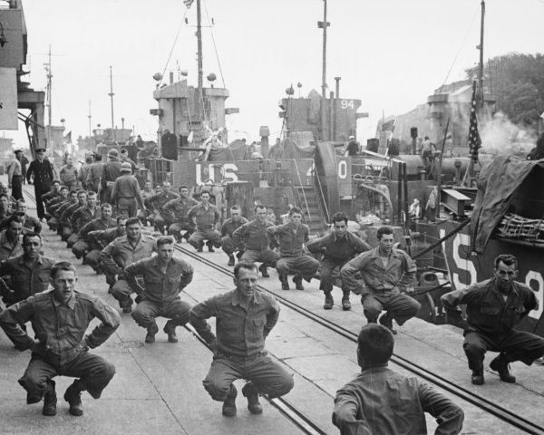American soldiers use the dockside in a small English harbour to keep fit during the pre-landing period
