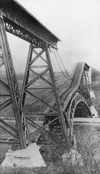 A damaged bridge in north eastern France during the First World War. The French adopted the tactic of blowing up bridges to halt the German advance. Date: 1914