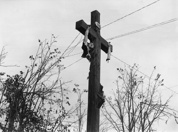 A damaged wayside crucifix near Bellenglise, northern France, towards the end of the First World War. Date: October 1918