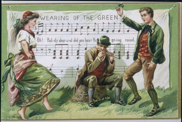 Two Irish dancers - one barefoot - dance a jig to the tune 'The wearing of the green&#39