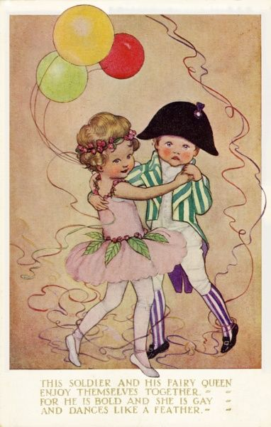 Two children at a fancy dress party dance together, he in a striped suit reminiscent of the French Revolution and she in fairy style tutu