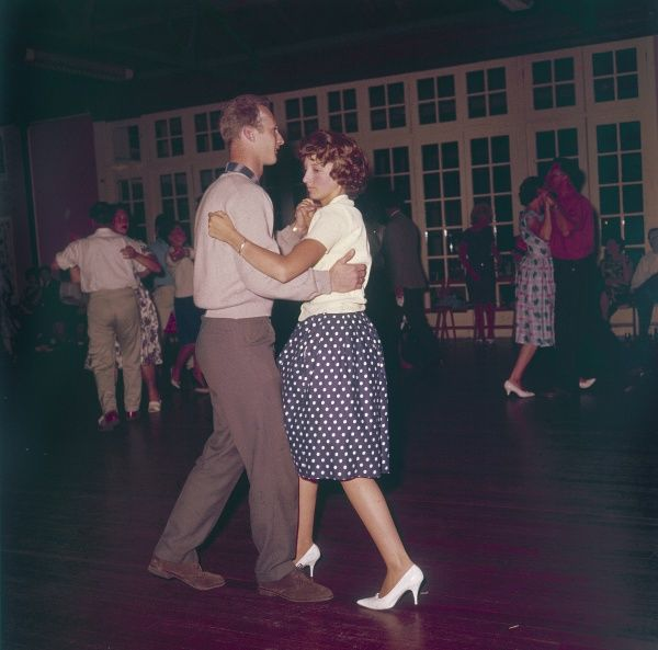 Young couples dancing together. Date: early 1960s