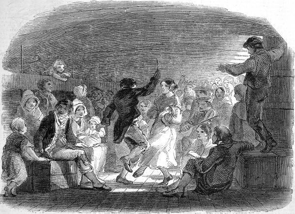 Engraving showing passengers on board an emigrant ship playing music and dancing on the lower deck, 1850