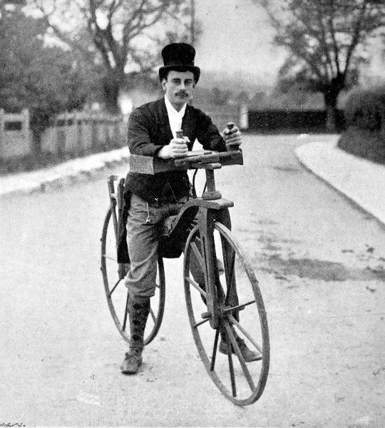 Photograph of a 'cyclist' and his 'Dandy-Horse'; an early bicycle or 'running machine' without pedals or gears, propelled only by foot