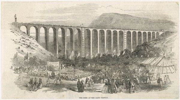A Grand Fete is held beneath the Dane Viaduct, Staffordshire to celebrate its completion. The banner on the left of the picture reads: 'To the Workmen of Great Britain&#39