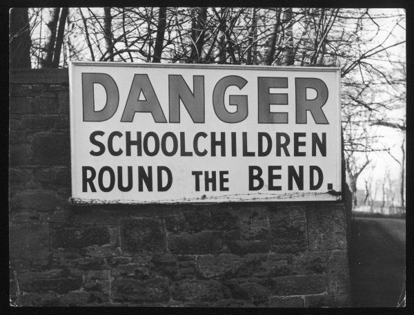 This warning notice, reading 'Danger, schoolchildren round the bend', could have been worded a little differently!