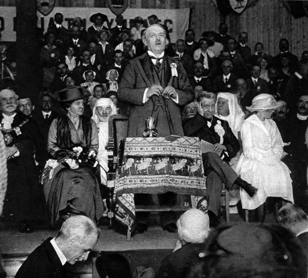 Photograph of David Lloyd-George (1863-1945), 1st Earl Lloyd-George of Dwyfor, the Welsh Liberal statesman, taken during a speech at the Welsh National Eisteddfod, Birkenhead, 6th September 1917. Also on the platform were Mrs. Lloyd-George